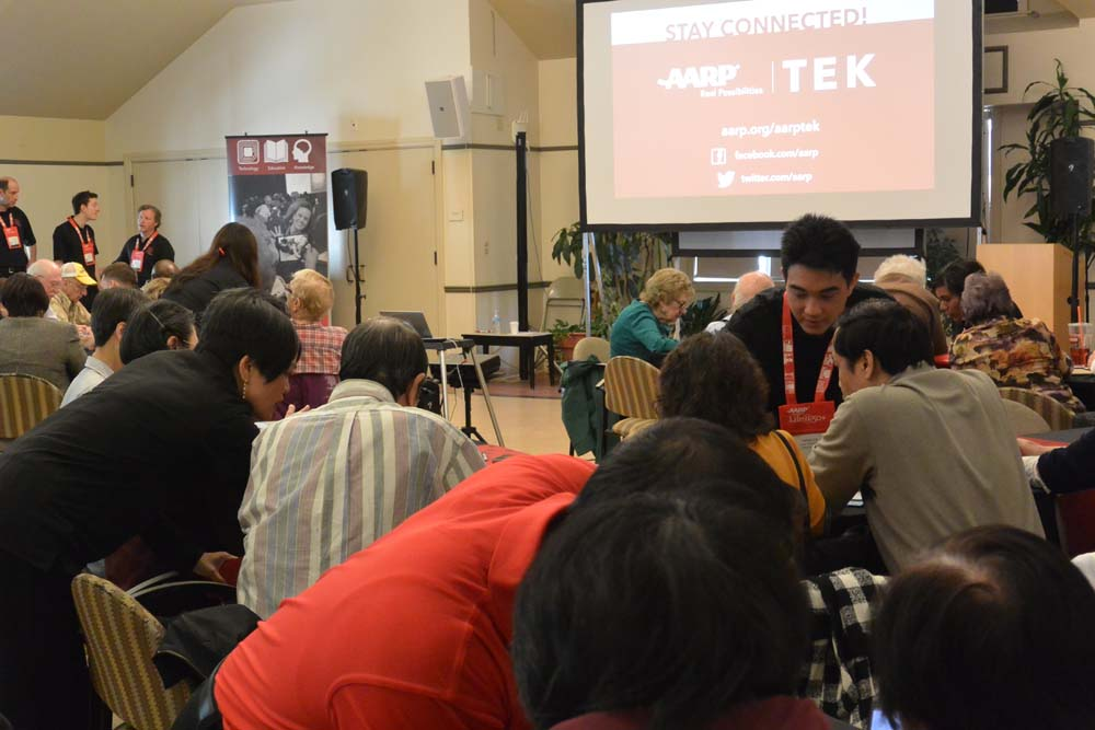AARP's TEK team helped elderly Chinese at a senior center in Boston learn to use smartphones, and they were sending texts ad shooting selfies at the end of the session.