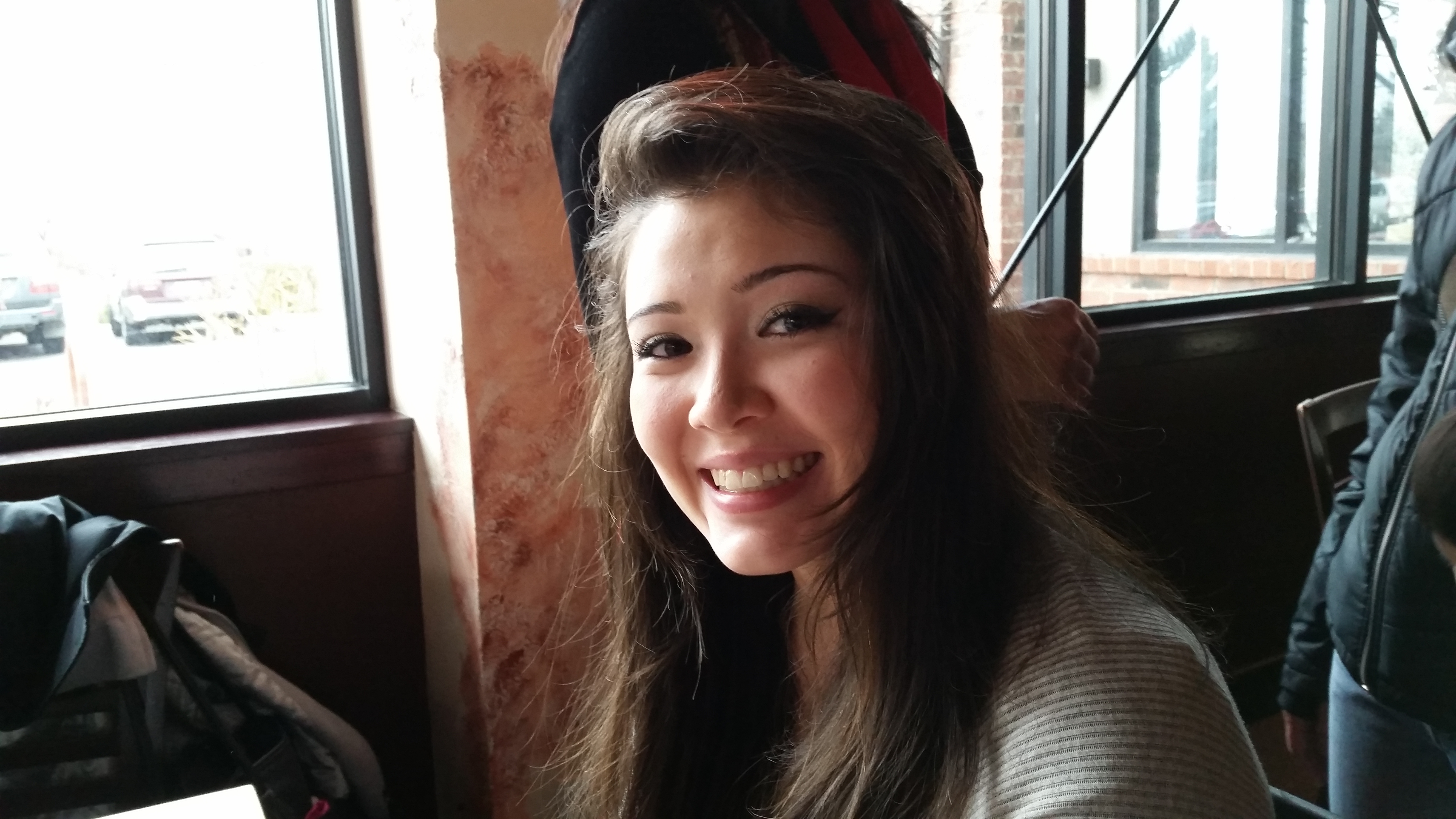 """My beautiful mixed-race niece, Sage, who calls herself """"hapa."""" This photo was taken on Christmas Day 2014 during a family meal at ... where else? ... a Chinese restaurant."""